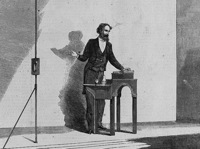 Wood engraving of Dickens giving a reading in 1867.