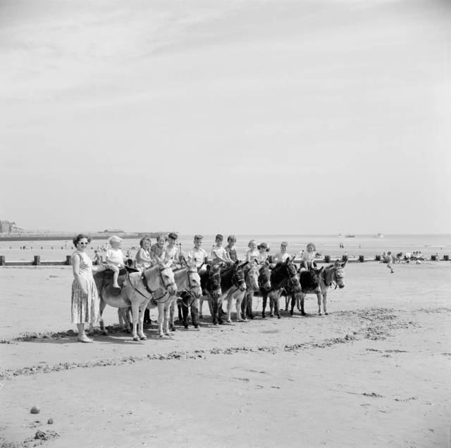 Line of donkeys on the beach at Bridlington 1931 – 1980 © Historic England Archive. Ref: AA99/00354