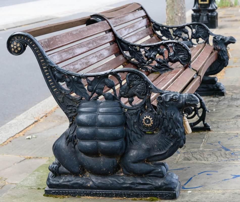 Bench with cast-iron kneeling camel armrests
