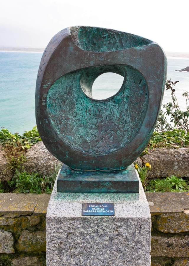Detail view of the bronze sculpture 'Epidaurous' by Barbara Hepworth, with the sea behind
