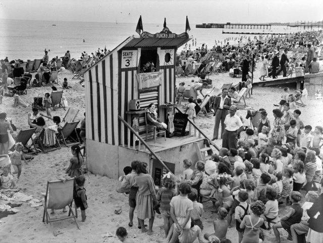 Children enjoy Punch and Judy at Lowestoft in 1949 © Historic England Archive OP00075