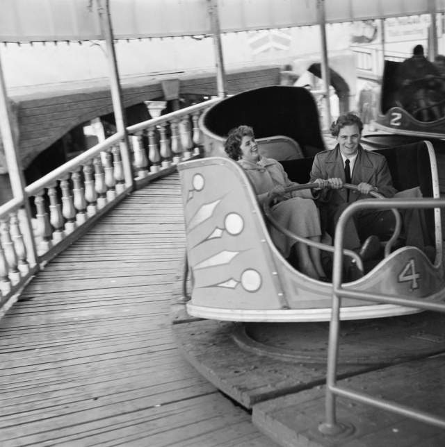 A couple of a fairground waltzer during a trip to Skegness