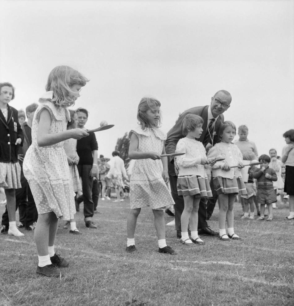 Young girls lined up at the start of the egg-and-spoon race