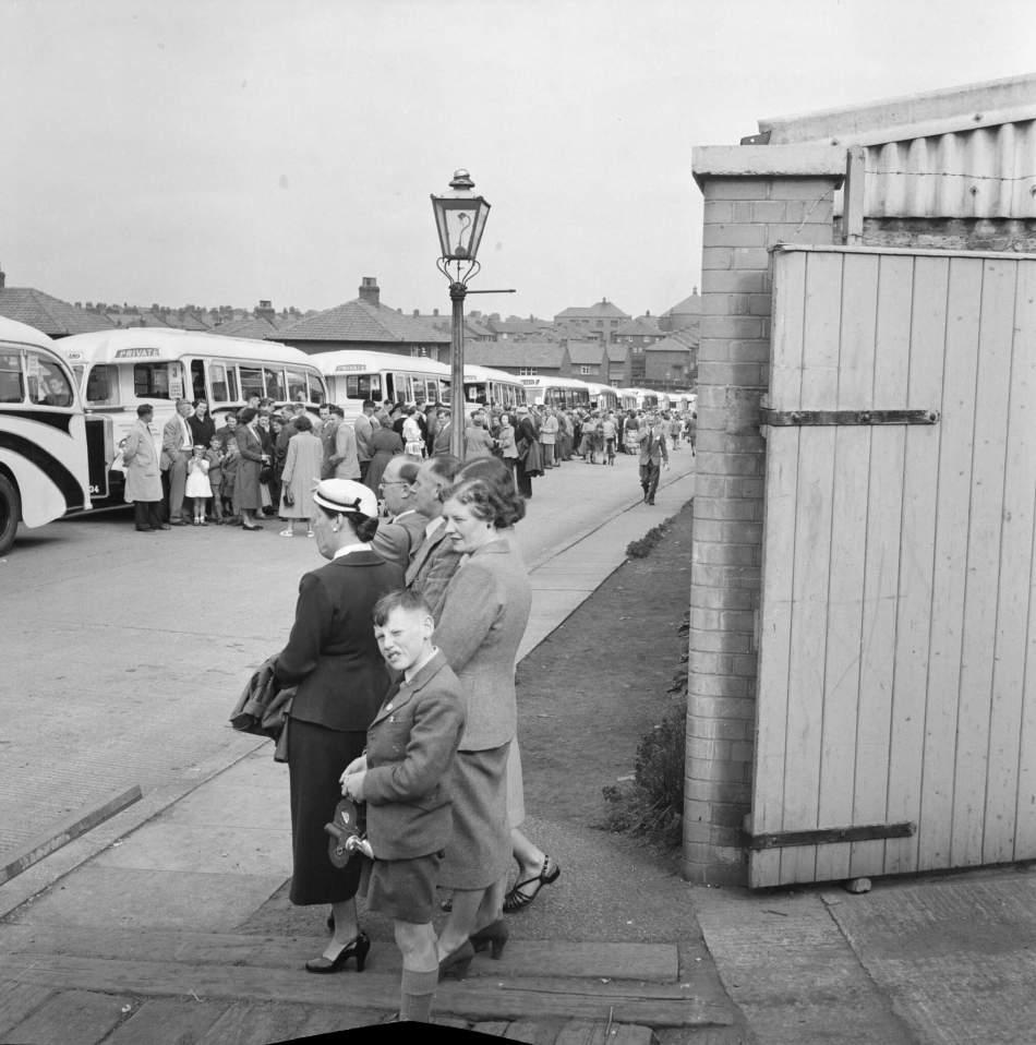 Families queue for coaches