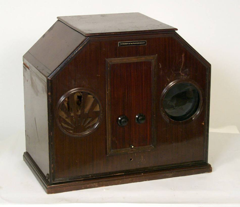 Baird Model B 'Noah's Ark' Televisor. A small number were constructed at the Long Acre studio, representing the first 'mass-production' of television sets. In 1927, the world's first TV sets were sold in Selfridges, reputedly costing the price of a small car. Image via creative commons.