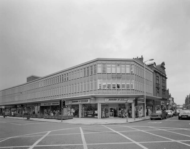 The junction of Market Street (left) and Bradshawgate (right), 1987. The vehicles are emerging from Bradshawgate, at the point where Ranicar's clog shop once stood © Historic England Archive BB94 07539