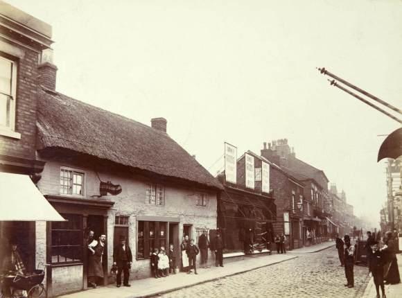 The premises of Peter Ranicar, Clog Maker, Bradshawgate, Leigh, Lancashire, late 19th century, © Historic England Archive AL2409/016/01
