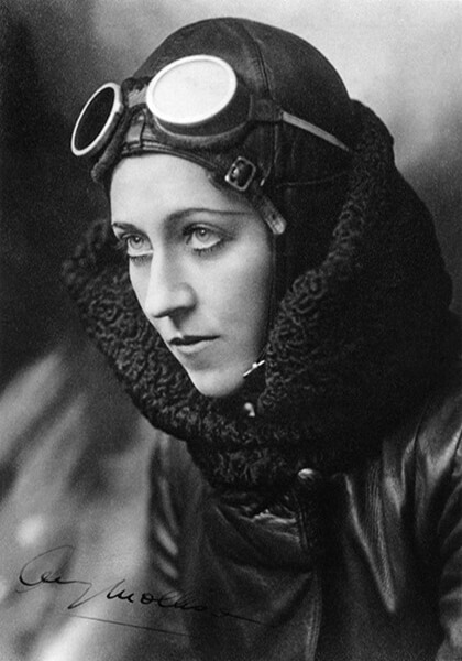 Portrait of Amy Johnson in flying gear.