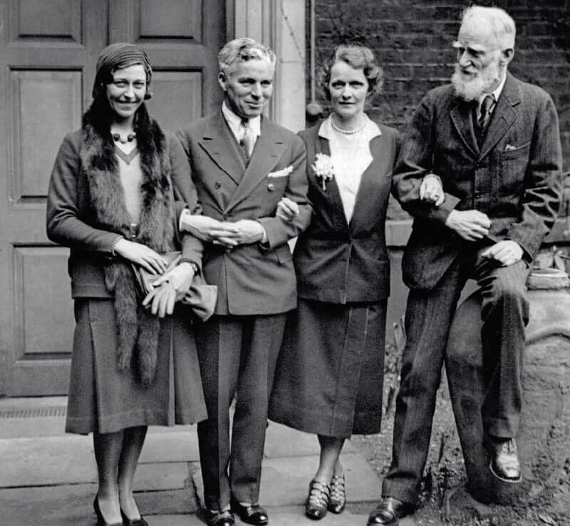 Amy posing with, to her left, comedian and film star Charlie Chaplin, the American-born British politician Lady Nancy Astor and Irish playwright George Bernard Shaw