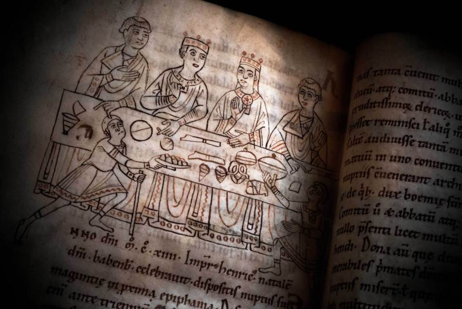 Detail from a medieval manuscript depicting a banquet.