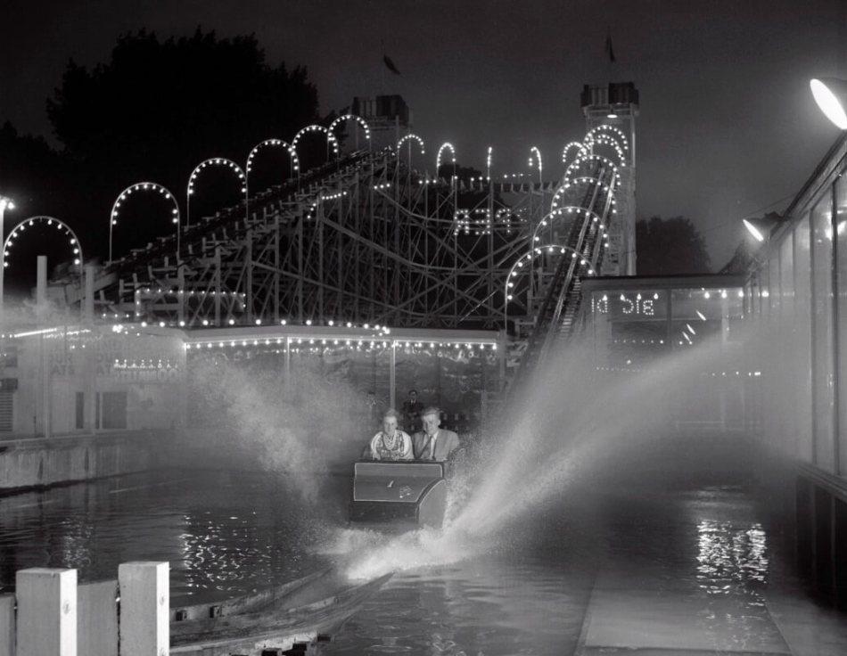 Two passengers on Water Splash at night