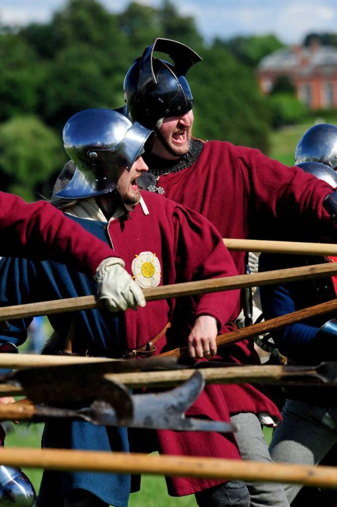 Reenactors dressed a Wars of the Roses billmen in a recreation of a battle.