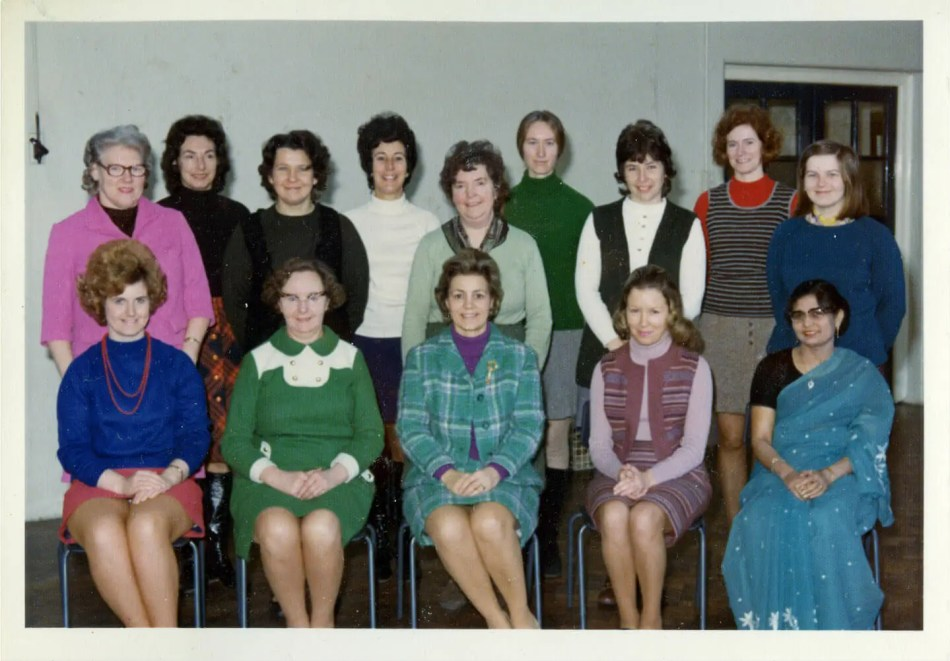 14 female teachers sit/stand for the photo