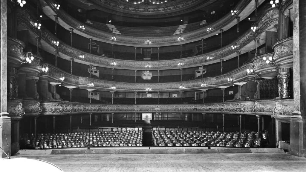 Drury lane theatre, photograph taken from the stage looking into the stalls with four circles of seating.