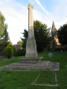 War memorial in Gertude Jekyll's village. If there were any place where it was natural for Lutyens to design a war memorial, it would have to be the Surrey village of Busbridge, home of the celebrated garden designer, Gertrude Jekyll, with whom he collaborated on a number of important house and garden designs. He designed nearby Munstead Wood, her house outside the village. Here in the St John the Baptist churchyard he used a variation of his tall tapered War Cross in Portland stone, standing it on an undercut plinth - another typical Luytens' design feature. The memorial was unveiled on 23 July 1922. The churchyard also contains three graves designed by Lutyens - of Gertrude Jekyll (together with her brother and sister-in-law), her mother Julia Jekyll and Francis McClaren, husband of her niece, who was killed in a flying accident during the war. Lutyens' other work in the village is the chancel screen in the church. Photo courtesy of Tim Skelton