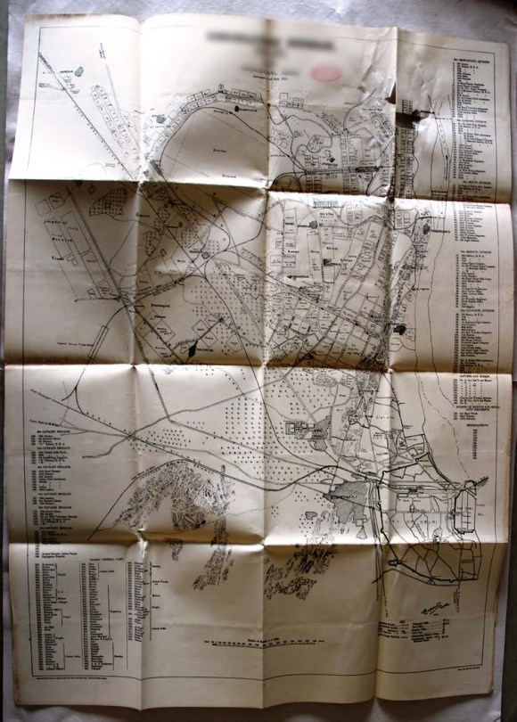 The pictures, maps and documents in this scrapbook