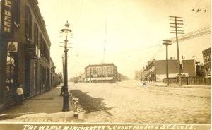 "Real photo postcard (RPPC) of Sarah & Chouteau Ave. in St. Louis, Missouri. The ""X"" marks where the pharmacy is."