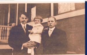 Gerard W.(G.W.) Helbling holding his son Edgar and with his father, Francis X. Helbling, on the right. c1908