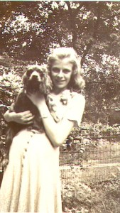 Mary T. Helbling as a young teen with one of the family's cocker spaniels, c late 1930s.