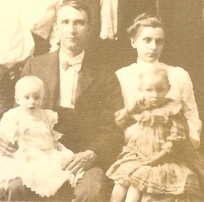 1904 Underwood Family Portrait-James Emroe Underwood holding their son Dallas Franklin Underwood and his wife Lola Ann Dameron Underwood holding their daughter Lovia Marie Underwood-cropped.