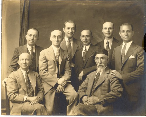"John Jacob/Zelig Broida and his seven sons. From left- front sitting- Max,standing- Phillip, Joseph J., Morris, Louis, Theodore, Harold. Sitting on right- John J. ""Zelig"" Broida."