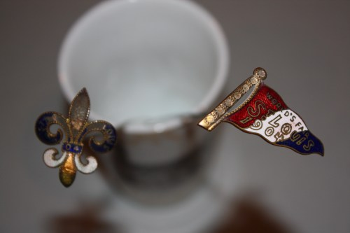 Souvenir of 1904 St. Louis World's Fair-2 enamel hatpins.