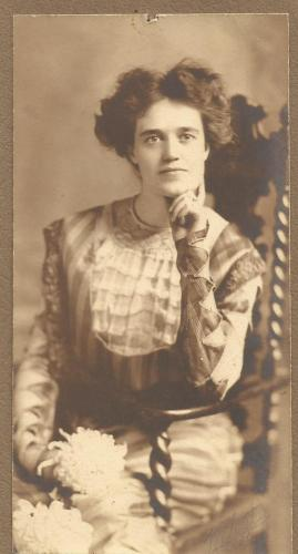 Lynette Payne, December 1909, wearing a purple and lavender silk dress.