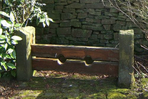 The old village stocks in Chapeltown, Lancashire, England, via Wikimedia, CC by 2.5 license, author Austen Redman.