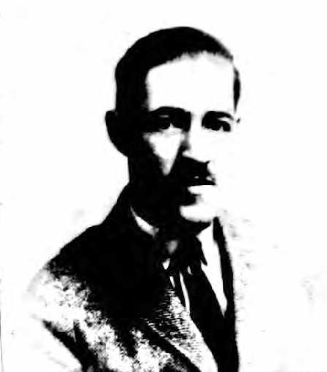 Leonard BROIDA1923 passport picture via Ancestry.com.