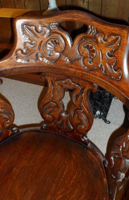 Likely John Broida's chair, brought to US from Eastern Europe; close-up of carved backrest.