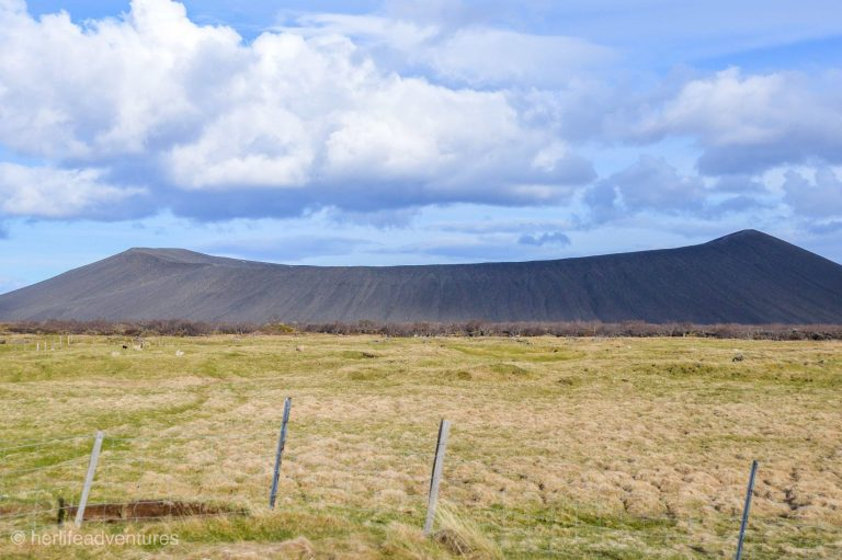 Hverfjall crater is located in North Iceland. A hike takes you to the top of the massive crater you can see from the road.