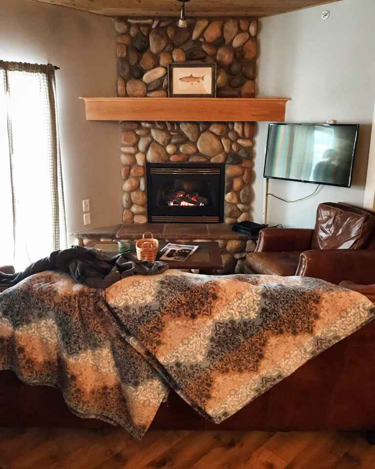 AirBnb Condo Fireplace Montana The adventure guide to Big Sky Montana in the winter. | herlifeadventures.blog | #traveldestinations #travelideas #northamericatravel #usdestinations #travelhacks #travelguide #adventuretravel  #bigsky #montana #adventureguide #winteractivities #wintertravel