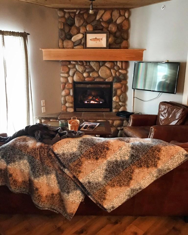 AirBnb Condo Fireplace Montana The adventure guide to Big Sky Montana in the winter. | herlifeadventures.blog | #traveldestinations #travelideas #northamericatravel #usdestinations #travelhacks #travelguide #adventuretravel  #bigsky #montana #adventureguide #winteractivities #wintertravel