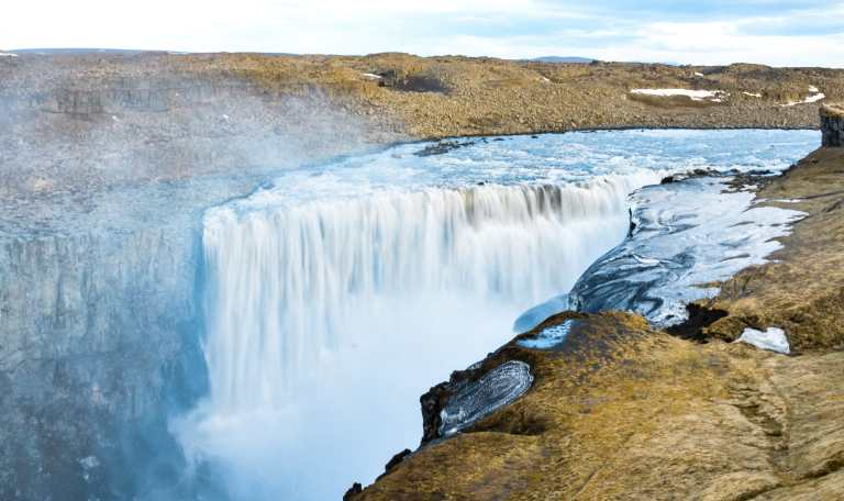 Dettifoss, and more must see waterfalls on your Iceland road trip around the ring road.  Hidden gems, cascading waterfalls and some of the most beautiful landscape I've ever seen. | herlifeadventures.blog |  #icelandtravel #hiddengem #icelandvacation #travelhacks #travelguide #adventuretravel #traveltips #europe #traveldestinations #travelexperience #waterfalls #iceland #beautifulplaces #adventure #explore