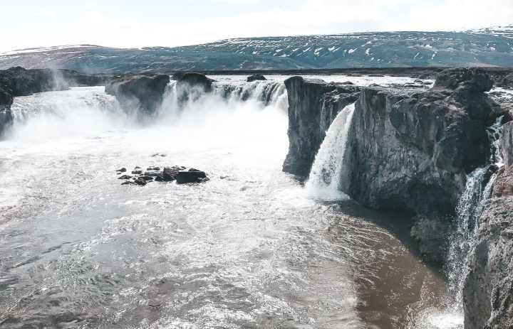 Godafoss and more must see waterfalls on your Iceland road trip around the ring road.  Hidden gems, cascading waterfalls and some of the most beautiful landscape I've ever seen. | herlifeadventures.blog |  #icelandtravel #hiddengem #icelandvacation #travelhacks #travelguide #adventuretravel #traveltips #europe #traveldestinations #travelexperience #waterfalls #iceland #beautifulplaces #adventure #explore