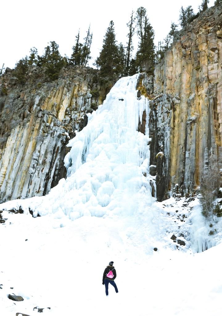 Frozen Waterfall rock wall The adventure guide to Big Sky Montana in the winter. | herlifeadventures.blog | #traveldestinations #travelideas #northamericatravel #traveltips #usdestinations #travelhacks #travelguide #adventuretravel #roadtrip #bigsky #montana #adventureguide #winteractivities #wintertravel