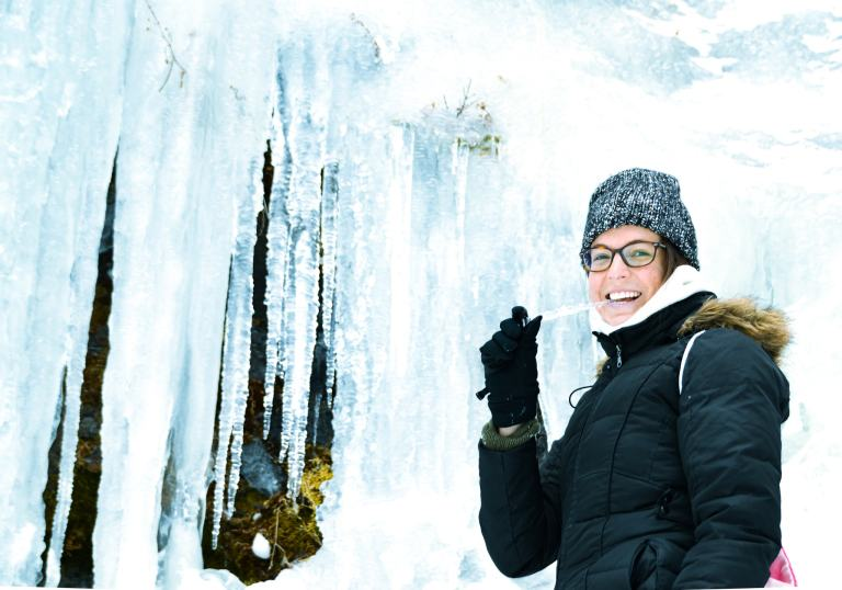 Eat icicles frozen waterfall The adventure guide to Big Sky Montana in the winter. | herlifeadventures.blog | #traveldestinations #travelideas #northamericatravel #traveltips #usdestinations #travelhacks #travelguide #adventuretravel #roadtrip #bigsky #montana #adventureguide #winteractivities #wintertravel