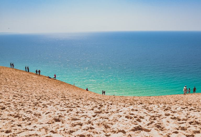 Sleeping Bear Dunes National Lakeshore is a large sand beach, with sand bluffs that tower 450' above Lake Michigan, lush forests, clear inland lakes, unique flora and fauna. Don't miss this incredible view.