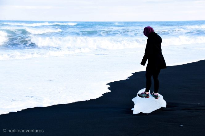 Iceland's black sand beach is covered in pieces of ice glittering like diamonds.