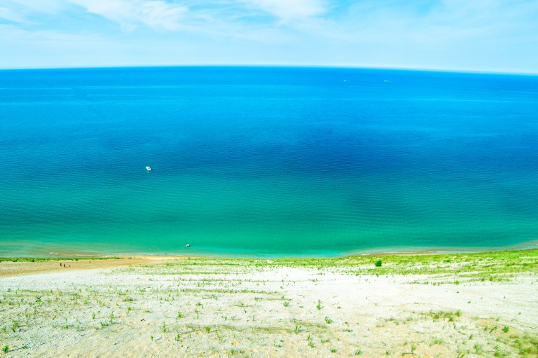 This Sleeping Bear Dunes itinerary covers the best of what to do on the National Lakeshore, how to get there and where to stay. Add this hidden gem to your summer bucket list. | Her Life Adventures | #camping #usdestinations #travelhacks #travelguide #adventuretravel #roadtrip #nationalpark #nationalparkroadtrip #michigantravel #greatlakes #ustravel #summer #bucketlist #sleepingbear #lakemichigan #sanddune