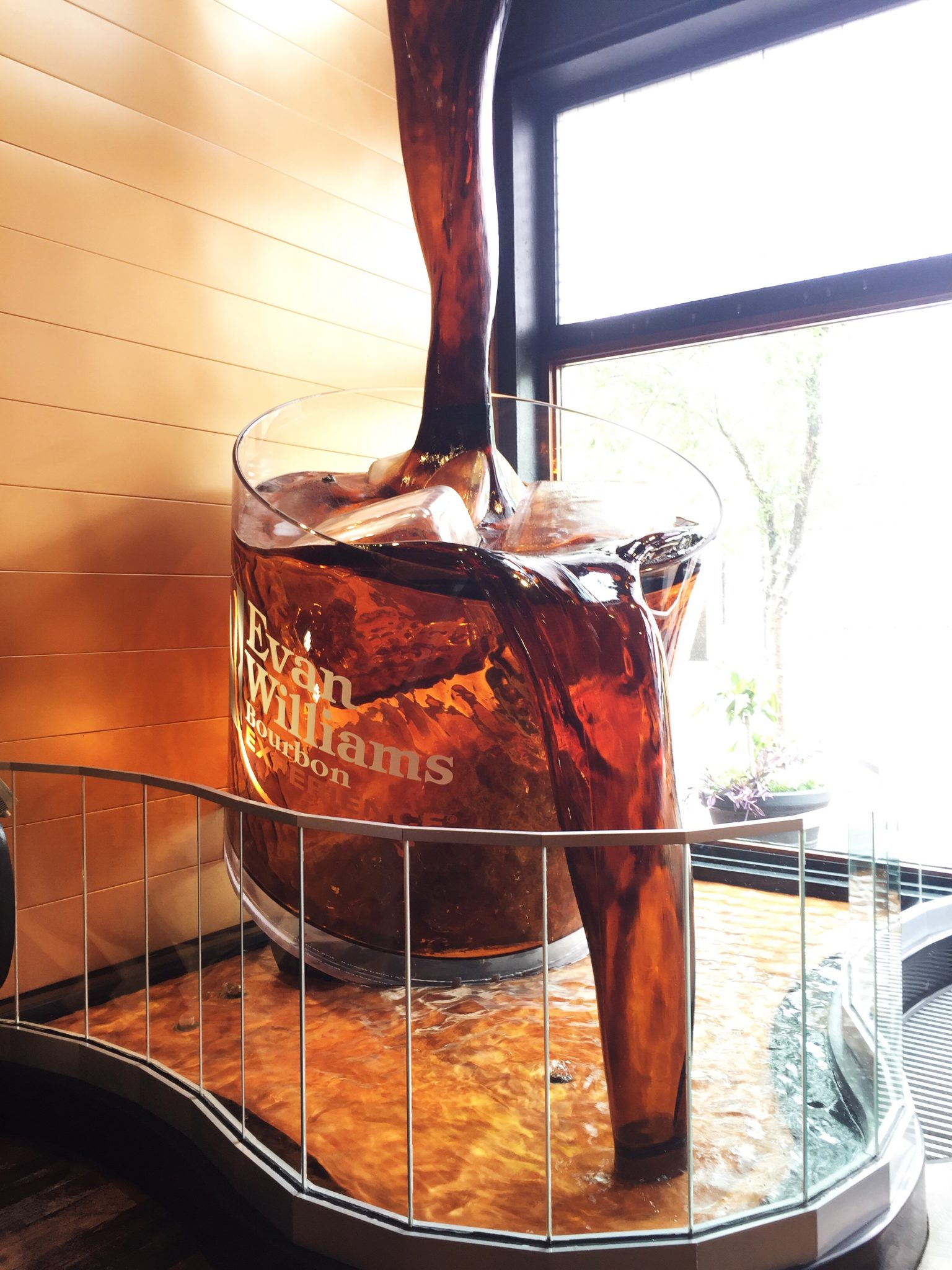 The drinking glass fountain at the entrance of Evan Williams Bourbon Experience