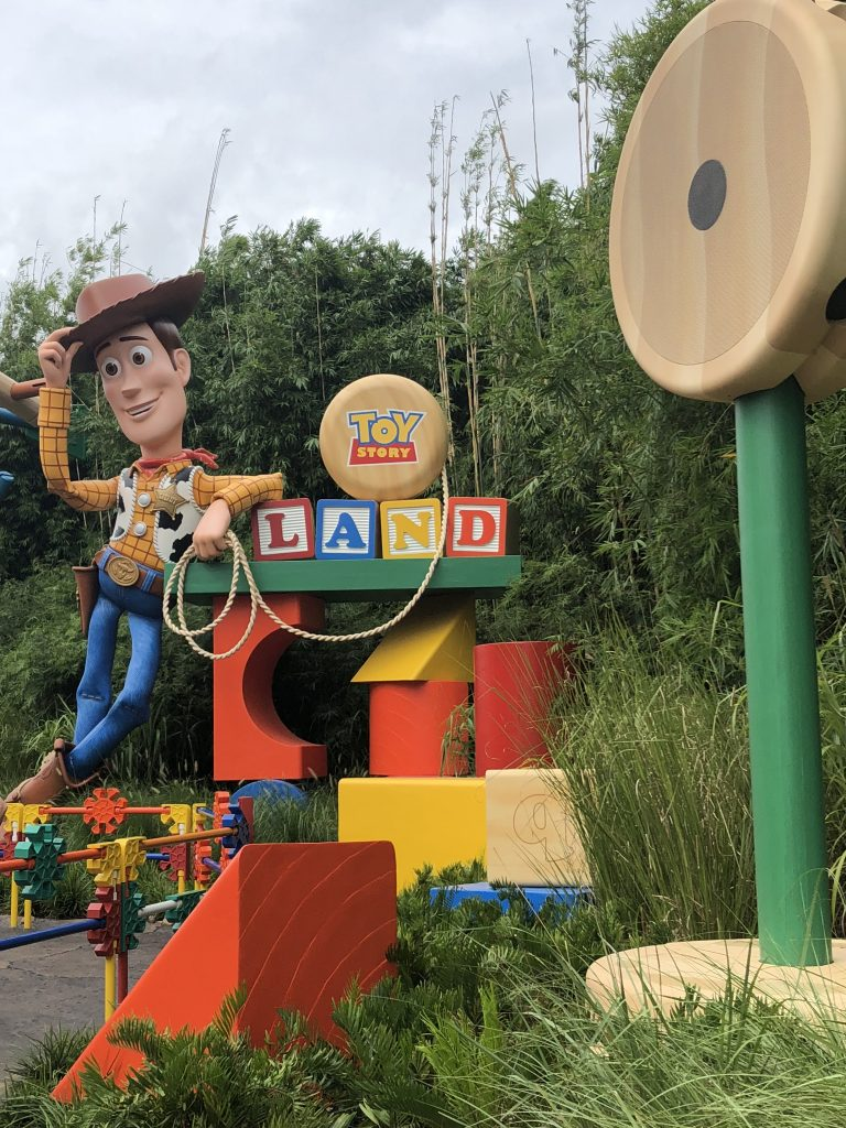 Woody welcoming visitors to Toy Story Land