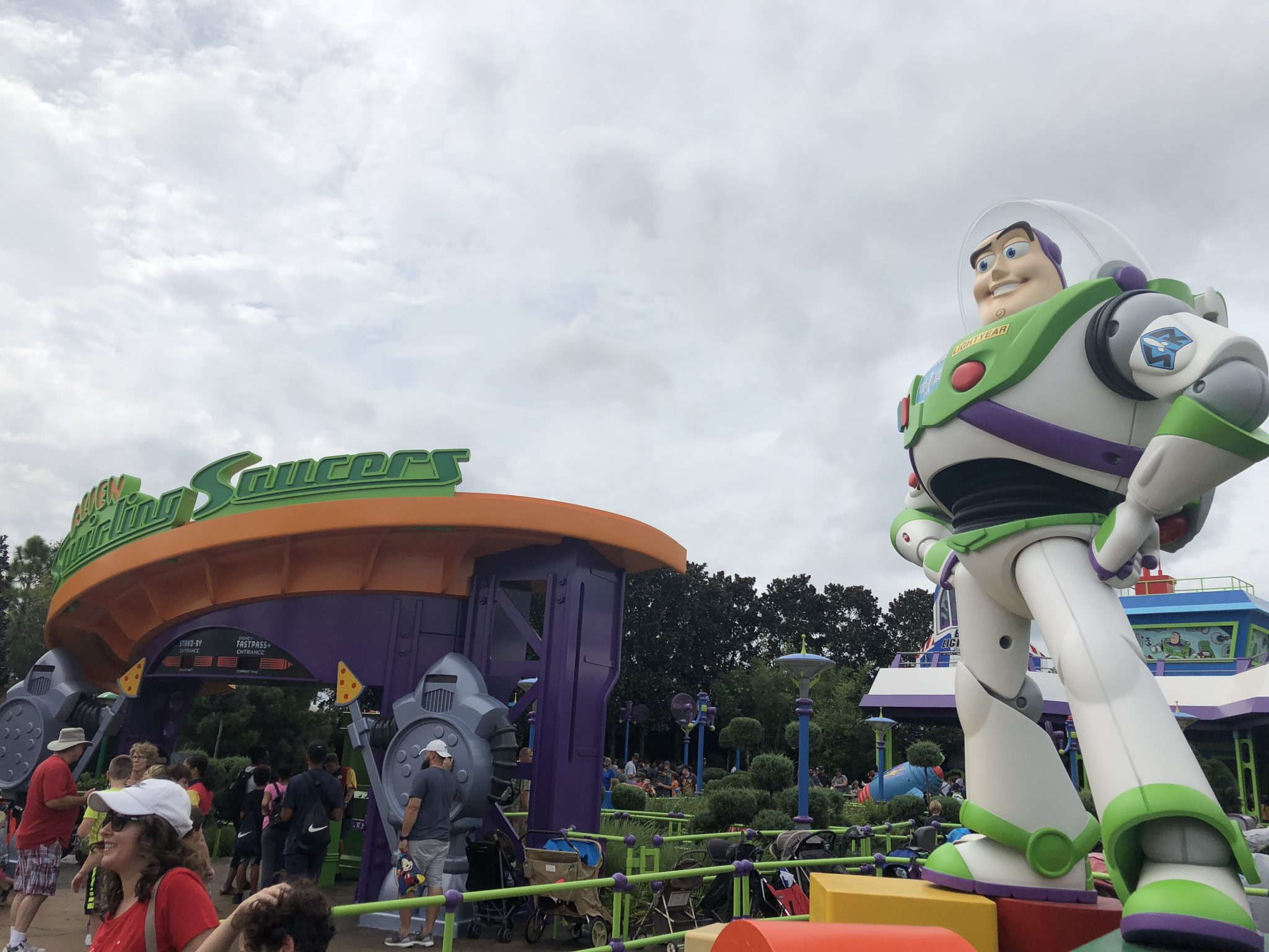 Buzz Lightyear statue standing outside Alien Swirling Saucers at Toy Story Land