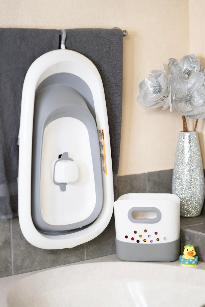 The OXO Tot splash and store bath tub is the best baby bath tub because of it's compact storage.