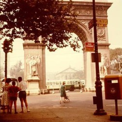 This older photo shows the Arch when traffic was still allowed in the Square.