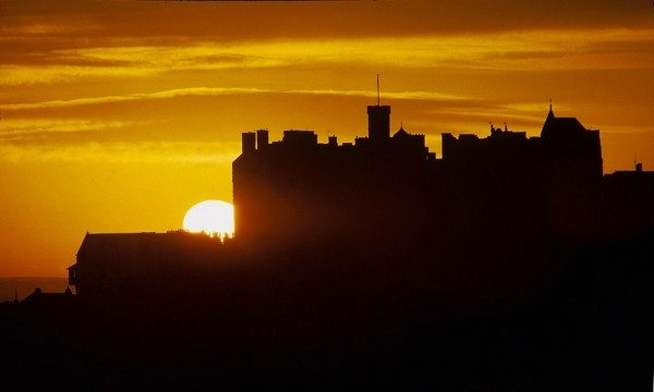 Edinburgh Castle silhouetted by a dramatic sunset. evening