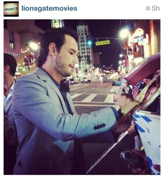 Rodrigo Santoro signs for his adoring fans at #TheLastStand Premiere