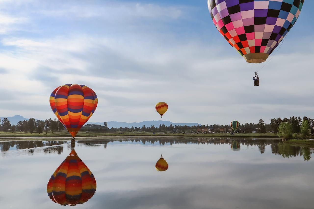 Hot air balloons over Village Lake