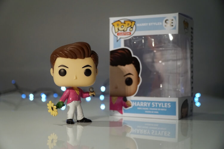 Harry Styles with sunflower Funko Pop Custom figurine on white surface, with box on side
