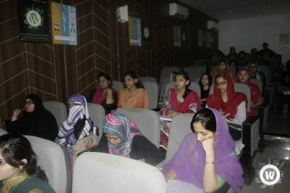Small theatre-style classroom filled with women